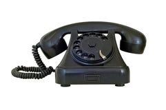 老葡萄酒黑色电话,隔绝在白色背景 库存图片