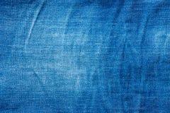 老蓝色牛仔裤 棉花牛仔布详细资料织品牛仔裤纹理 库存照片