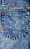 老蓝色牛仔裤 库存照片