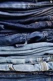 老蓝色牛仔裤 图库摄影