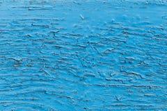 老蓝色绘了木头,被风化的有裂痕的表面 免版税库存图片