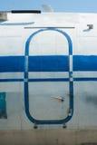 老蓝色被绘的飞机门关闭  免版税库存照片