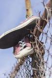 老被佩带的运动鞋 免版税图库摄影
