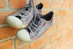 老被佩带的运动鞋 图库摄影