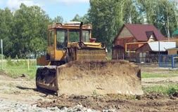 老被放弃的挖掘机 免版税图库摄影