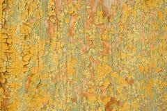 老被绘的镇压背景,在木Wal的破裂的油漆纹理 免版税库存图片