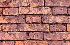 老被风化的红砖墙壁 免版税图库摄影