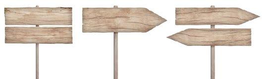老被风化的轻的木标志、箭头和路标 免版税图库摄影