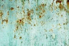 老被绘的深蓝生锈的墙壁纹理 免版税库存图片