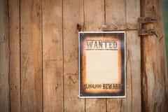 老西部标志,在木背景。 免版税库存图片