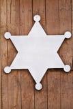老西部标志,在木背景。 库存图片