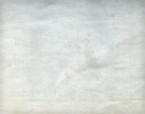 老起皱纹的肮脏的灰色纸板料 免版税库存照片
