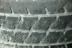 老轮胎踩 免版税库存照片