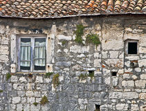 老达尔马希亚房子由石块做成 免版税库存照片