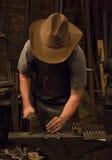 老野生西部铁匠 库存图片