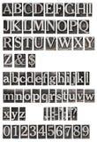 老金属在字母表上写字 免版税库存照片