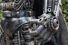 老铁做的英雄机器人的手 免版税库存照片