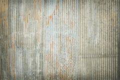 老锌纹理背景,生锈被镀锌的金属表面上 免版税库存图片