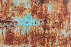 老难看的东西腐蚀了生锈的金属墙壁纹理 免版税库存照片