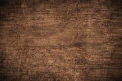 老难看的东西黑暗的织地不很细木背景,老棕色木纹理的表面,顶视图褐色木铣板 免版税库存图片