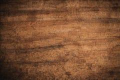 老难看的东西黑暗的织地不很细木背景,老棕色木纹理的表面,顶视图褐色木铣板 库存图片