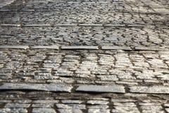 老鹅卵石路面特写镜头抽象背景  免版税库存照片