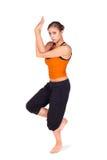 老鹰执行姿势实践的女子瑜伽 免版税库存图片