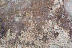 老黑暗的被风化的墙壁纹理背景 免版税库存图片
