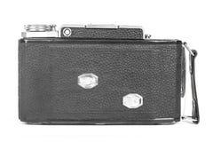 老,古色古香的袖珍照相机 黑照相机用黑皮革把柄盖 在白色背景的正面图 免版税库存图片