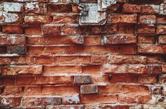 老,年迈的,生锈,被抓的,五颜六色的砖墙纹理/背景 图库摄影