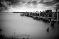 老,被放弃的码头废墟 免版税图库摄影