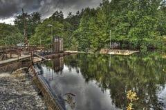 老水力发电站的水坝在HDR的 免版税库存照片