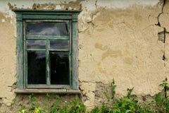 老黏土房子的墙壁 免版税库存图片