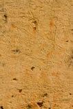 老轻的焦茶色的意大利灰泥墙壁纹理背景 免版税库存照片