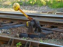 老黄色火车路轨转移 库存照片