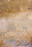 老黄色被弄脏的墙壁 Grunge纹理 免版税库存照片