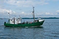 老绿色Fishboat 库存照片