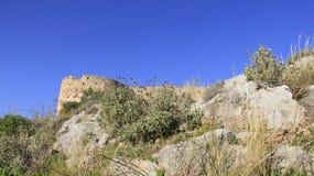 老Aptera大厦古老历史的地方有蓝天背景克利特海岛的 免版税库存图片