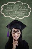 考虑她的未来事业的女性文凭 免版税库存照片