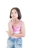 考虑的亚裔逗人喜爱的女孩画象  库存图片