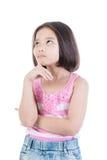 考虑的亚裔逗人喜爱的女孩画象  库存照片