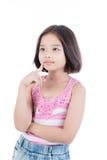 考虑的亚裔逗人喜爱的女孩画象  免版税图库摄影