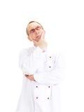 考虑食谱的厨师 免版税图库摄影