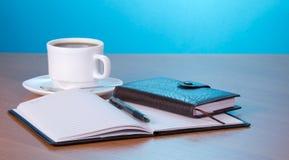 组织者和咖啡 免版税库存照片