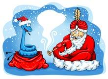 耍蛇者圣诞老人 图库摄影