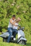 耦合摩托车本质滑行车年轻人 免版税库存图片