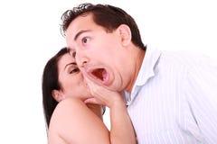 耳朵人s惊奇的某事告诉妇女 免版税库存图片