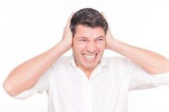 耳朵大声的人 免版税库存图片