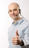 耳机人代表销售额 免版税库存照片