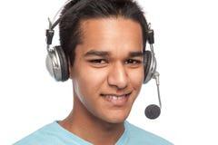 耳机人年轻人 图库摄影